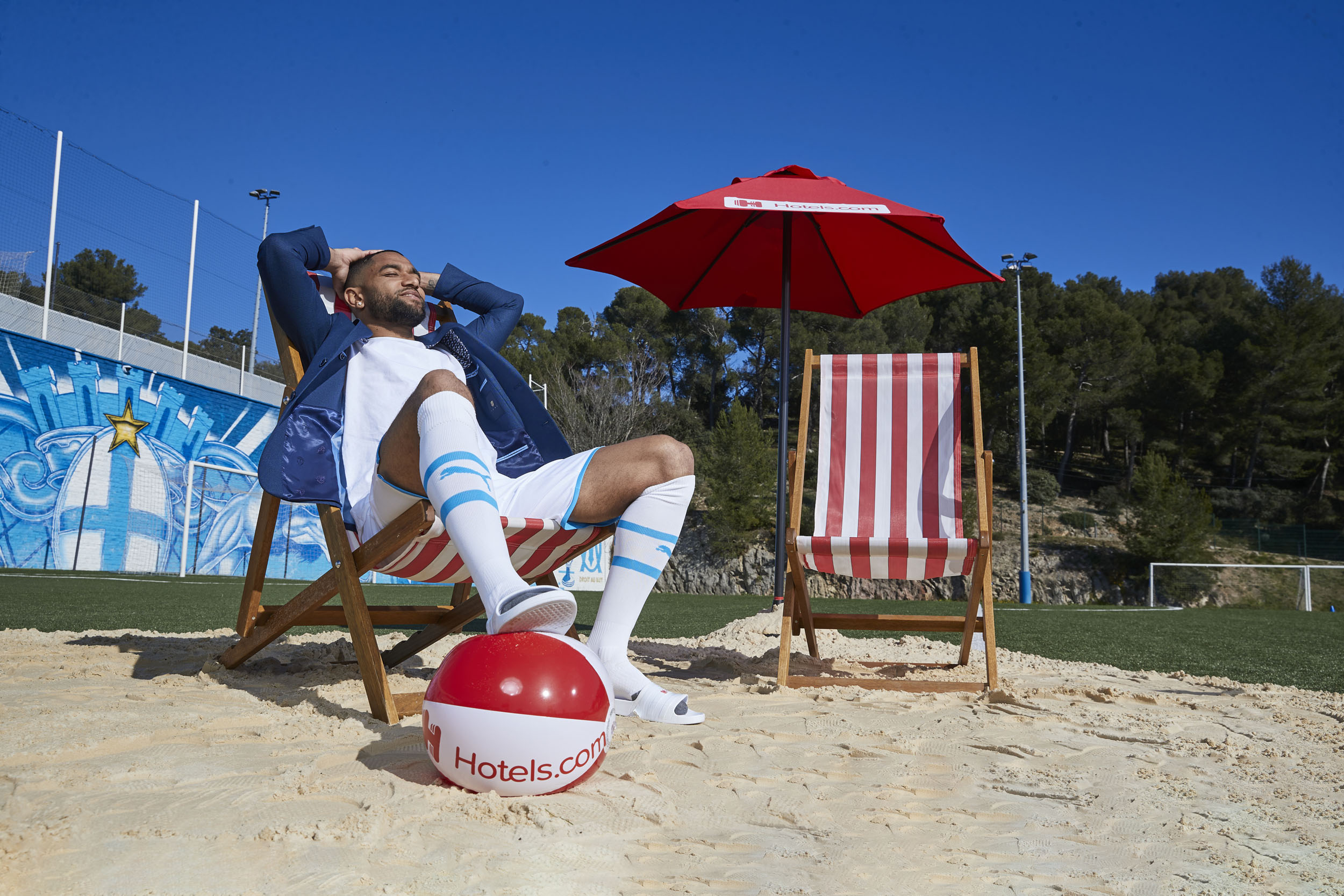 Steve Mandanda Olympique de Marseille Beach Ball Deckchair Hands Behind Heard Relaxed © Mark Robinson Photographer Hotels.com